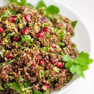 Festive Red Quinoa Tabouli with Pomegranate. A twist on traditional tabouli, this recipe uses red quinoa instead. A healthy salad flavoured with lemon.