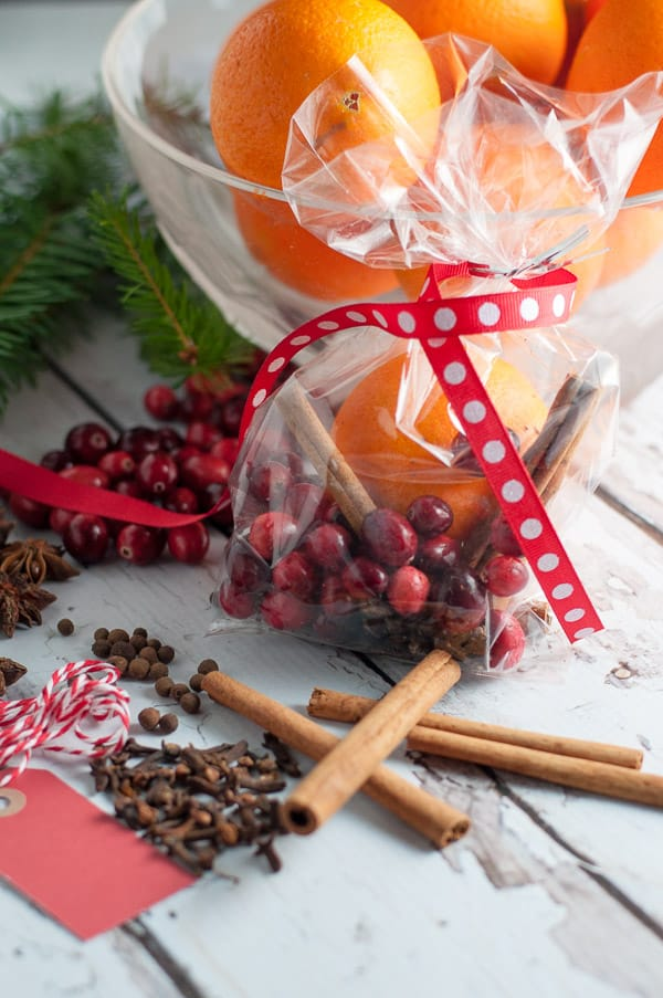 Holiday Simmering Slow Cooker Potpourri in clear gift bags tied with a ribbon