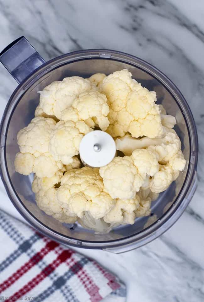 3 easy steps to make Cauliflower Rice. Put florets in food processor.