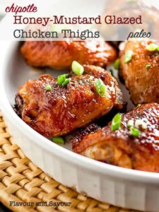 Smoky Chipotle Honey-Mustard Glazed Chicken Thighs in a white serving dish.