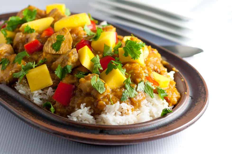 Sweet mangoes, spicy peppers and fresh lime combine to make this Slow Cooker Thai Mango Chicken a family favourite. Paleo and gluten-free.|www.flavourandsavour.com