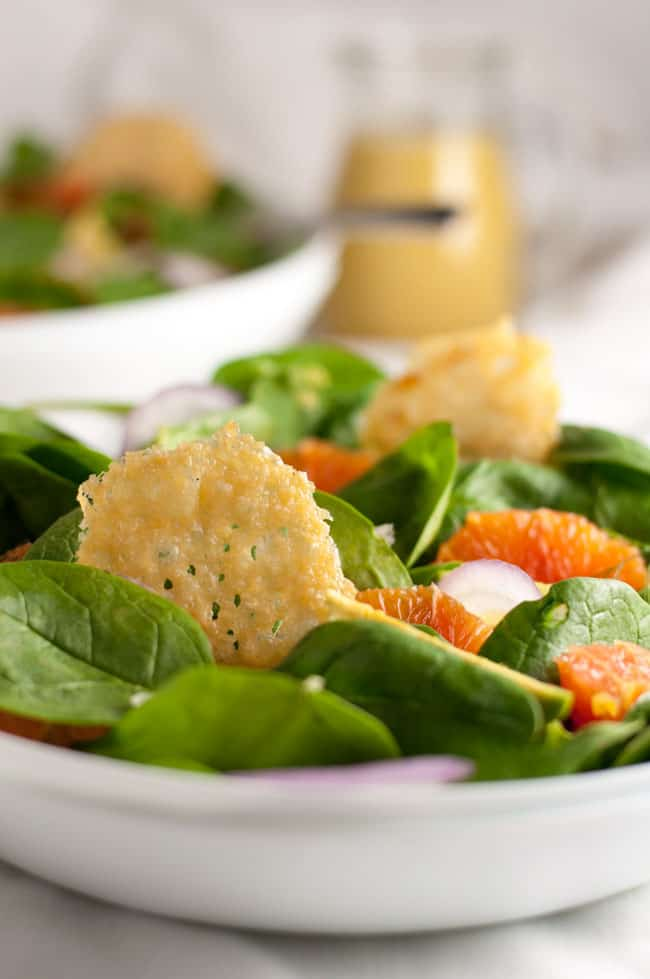 Orange and Avocado Salad with Parmesan Crisps. Sweet Cara Cara oranges, creamy avocados, fennel and red onion on a bed of fresh greens, garnished with crunchy Parmesan crisps. This salad can be a side salad or the base for a meal when you add grilled chicken or shrimp.
