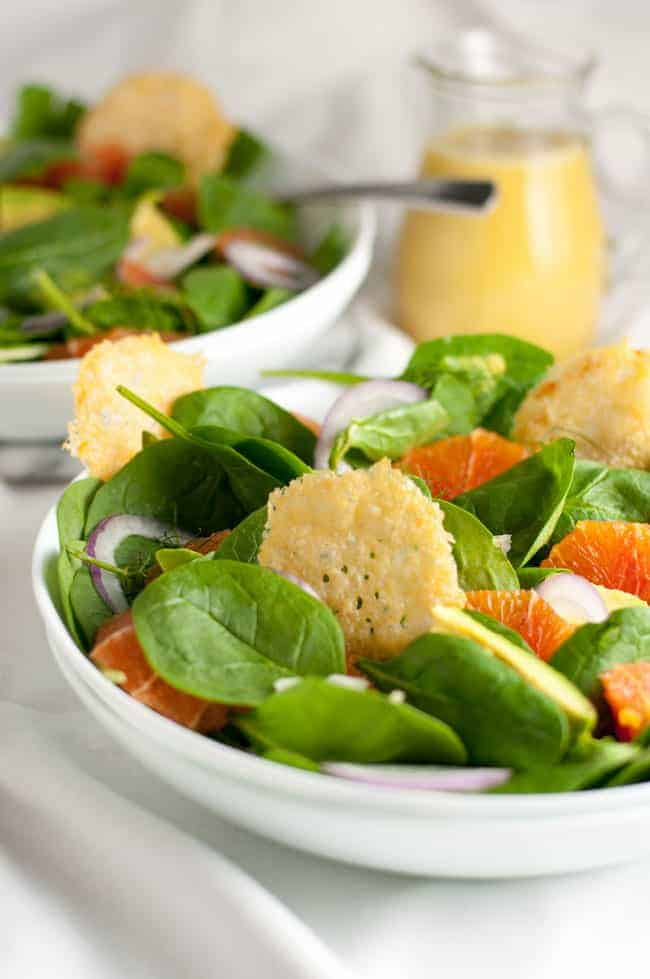 Orange and Avocado Salad with Parmesan Crisps. one of 10 recipes starring lemon from Flavour and Savour. Sweet Cara Cara oranges, creamy avocados, fennel and red onion on a bed of fresh greens, garnished with crunch Parmesan crisps.