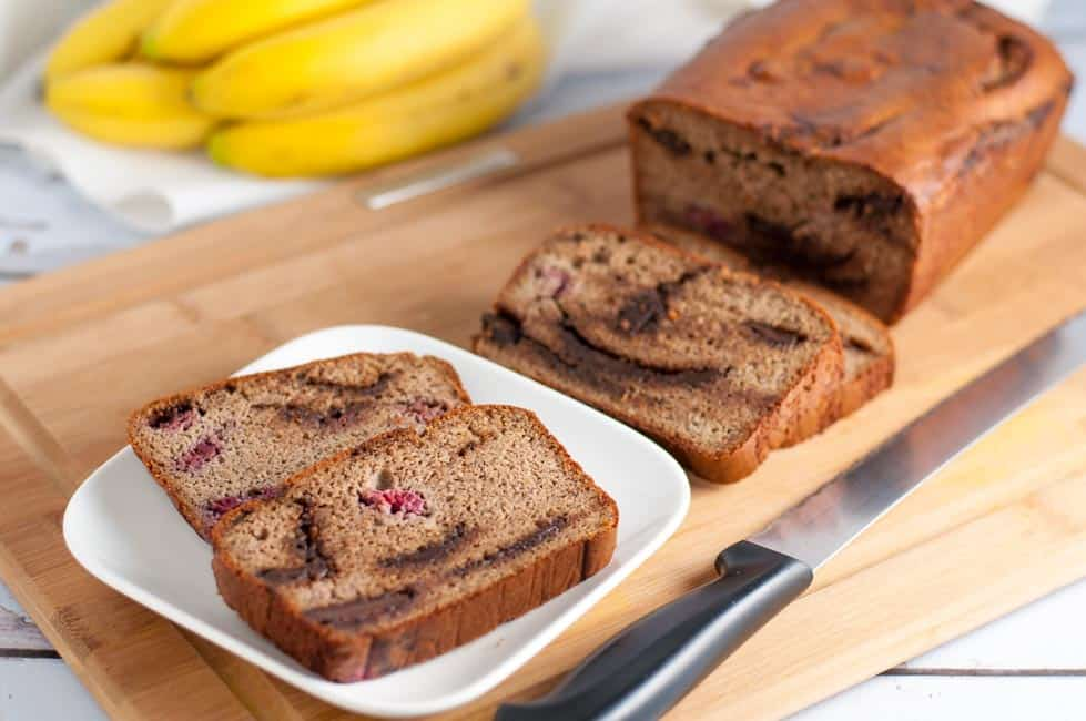 Chocolate Swirl Banana Bread with Raspberries. Grain-free, naturally sweetened banana bread. Rises beautifully, moist, chocolatey, and delicious!