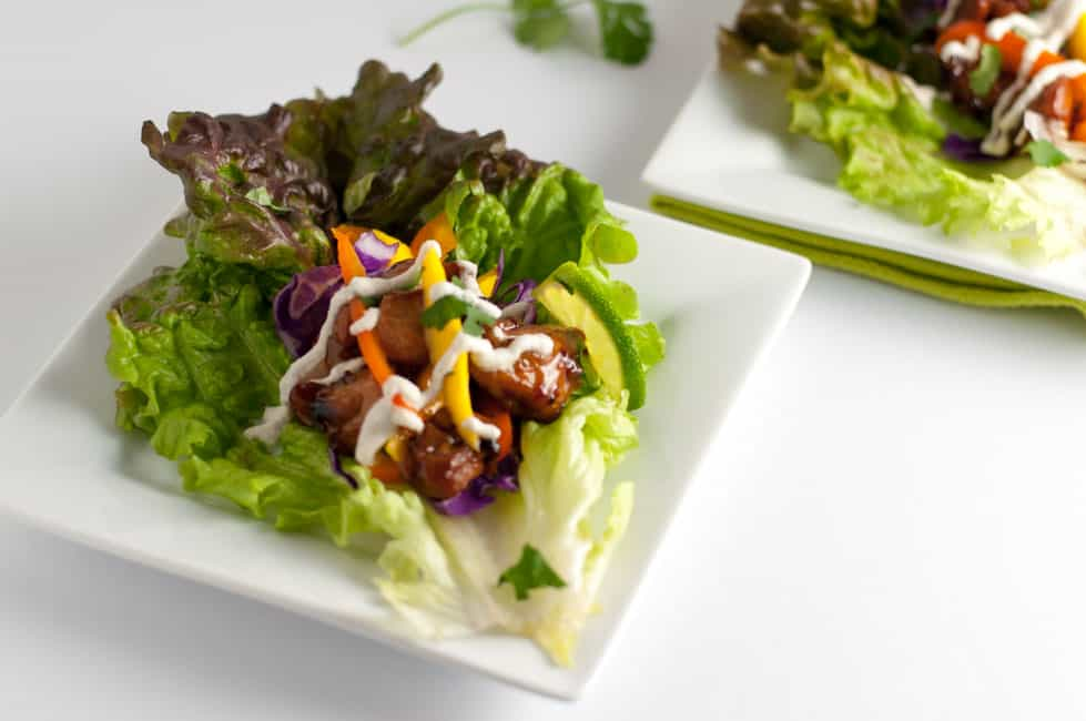Paleo Thai Chicken Lettuce Wraps with creamy cashew sauce.