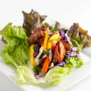 Thai Chicken Lettuce Wraps with Cashew Cream. Sweet and spicy chicken, peppers, mango, and crunchy cabbage all drizzled with a flavourful cashew cream makes a super dairy-free, gluten-free lunch or light dinner.
