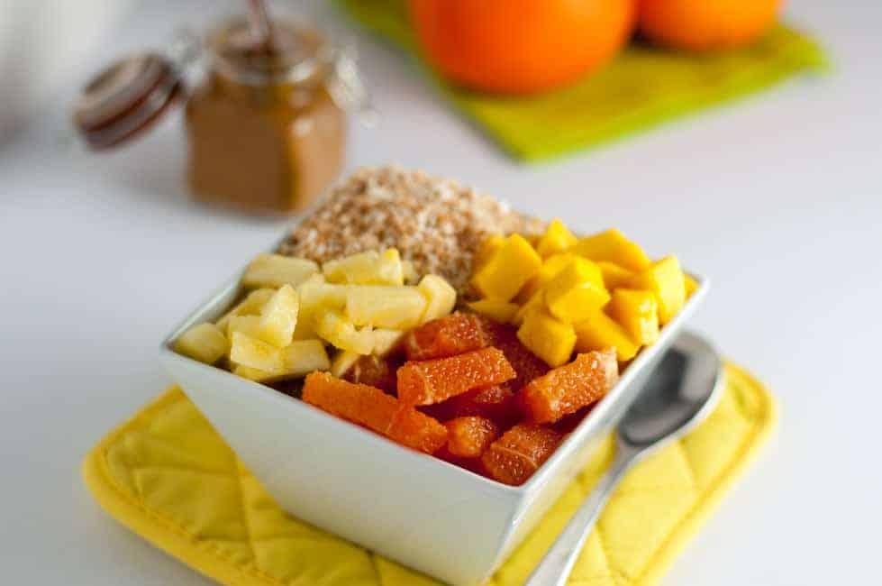Tropical Turmeric Smoothie Bowl. Pineapple, orange and mango top a tropical turmeric smoothie. Loaded with Vitamin C and anti-inflammatory turmeric.