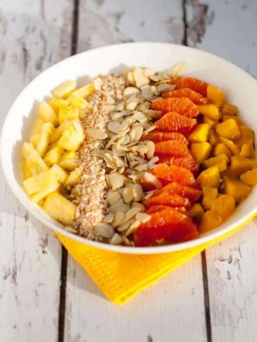 Tropical Turmeric Smoothie Bowl. A healthy way to start your day. Pineapple, orange and mango top a tropical turmeric smoothie. Loaded with Vitamin C and anti-inflammatory turmeric.