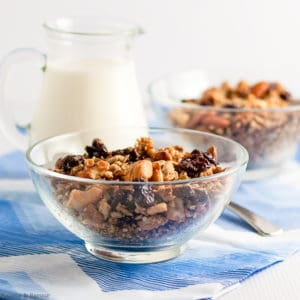Two bowls of granola on a blue cloth