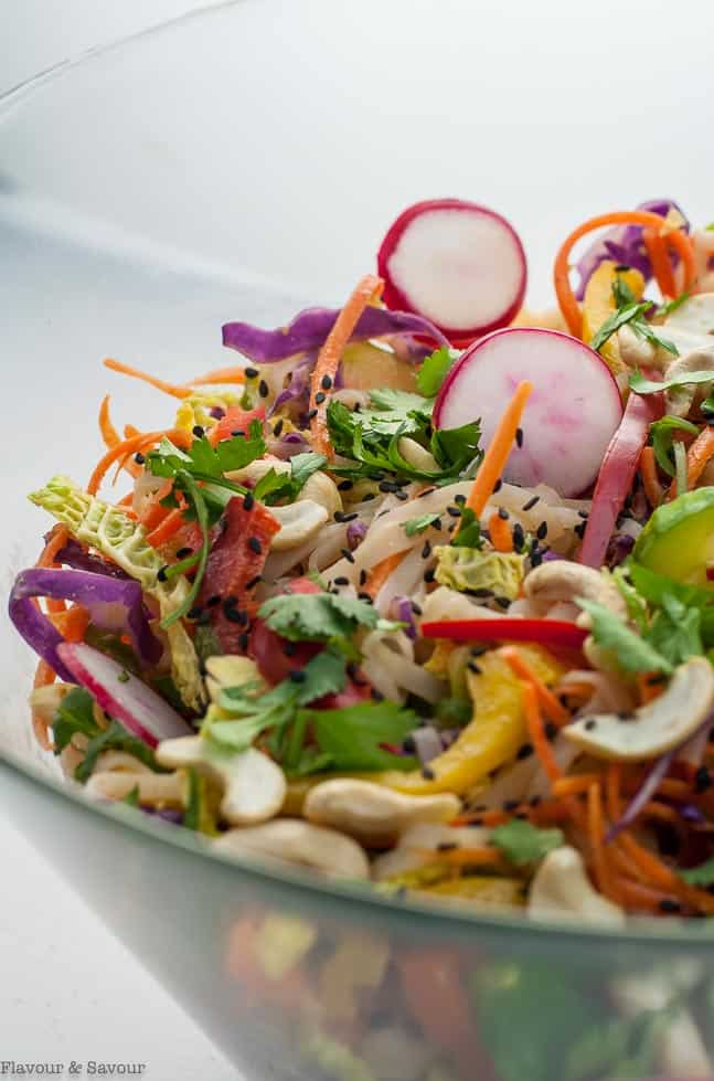 Thai style noodle salad in a glass serving bowl
