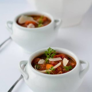 One-Pot Healthy and Hearty Tuscan Minestrone Soup. Brimming with rich Italian tomato flavour, this is an easy slow cooker soup. Set it and forget it!