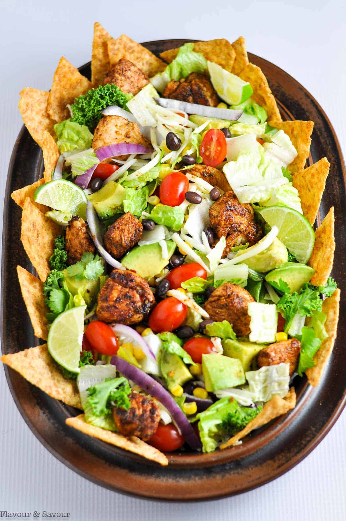 Overhead view of Chopped Chicken Taco Salad on an oval brown platter