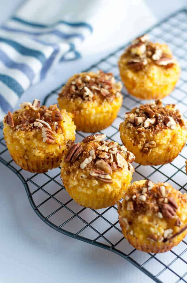 Paleo Pina Colada Muffins with Pecan Crumble on a cooling rack