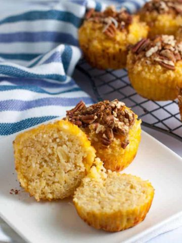 Paleo Pina Colada Muffins with Pecan Crumble. Grain-free, dairy-free and refined sugar-free too! Tropical flavours in a paleo muffin.
