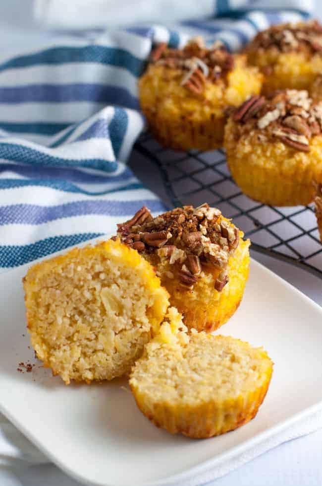 Paleo Pina Colada Muffins with Pecan Crumble split open on a plate
