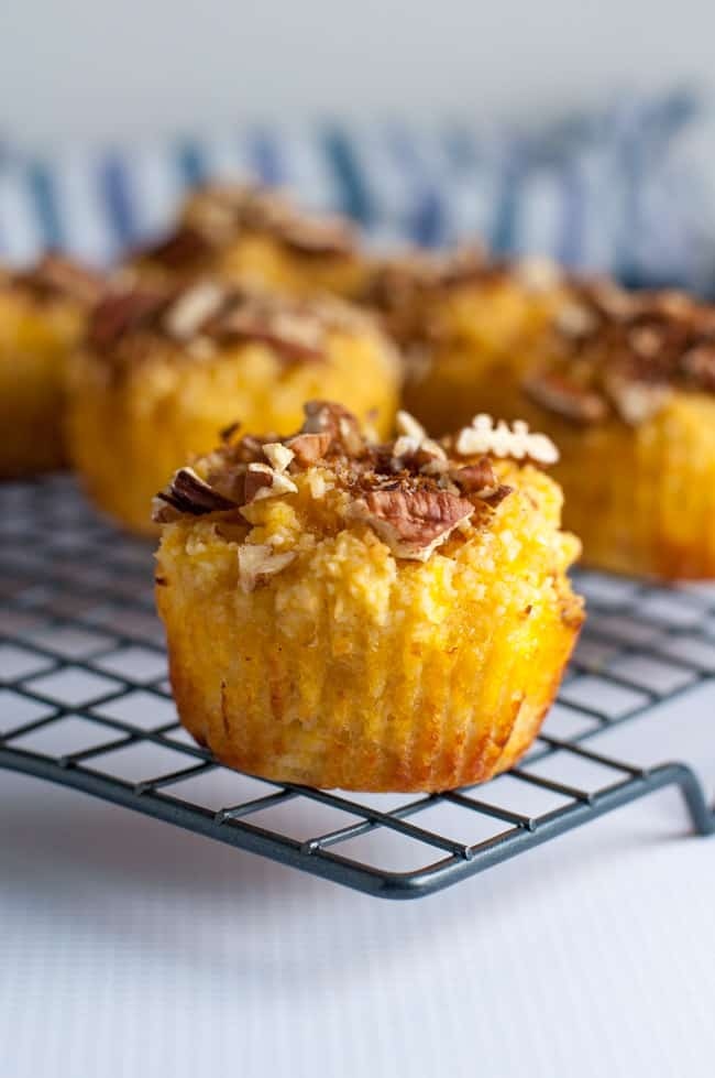 Paleo Pina Colada Muffins with Pecan Crumble. Close up view of a pineapple coconut muffin.