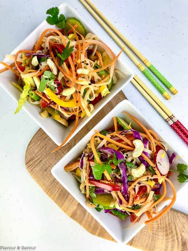 Thai Noodle Salad in two square bowls with chopsticks