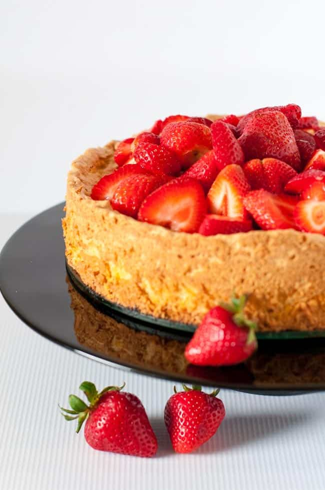 Close up view of Gluten-Free Lemon Almond Cake with sliced strawberries on top