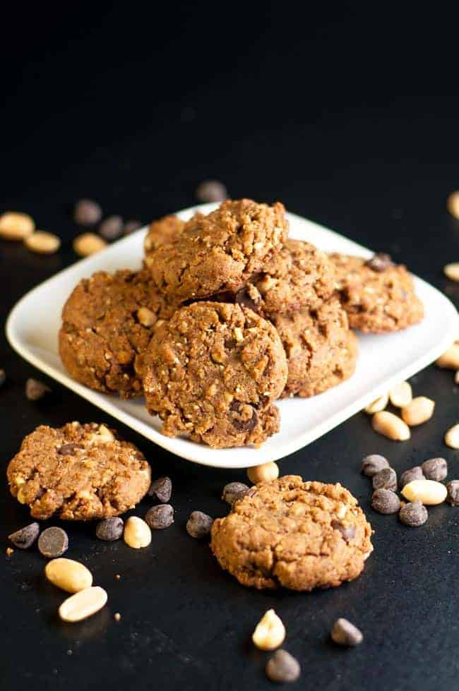 My Favourite Gluten-Free Peanut Butter Chocolate Cookies on a plate. This recipe makes a soft but sturdy flourless cookie with coconut palm sugar and added peanuts for crunch. Totally satisfying!