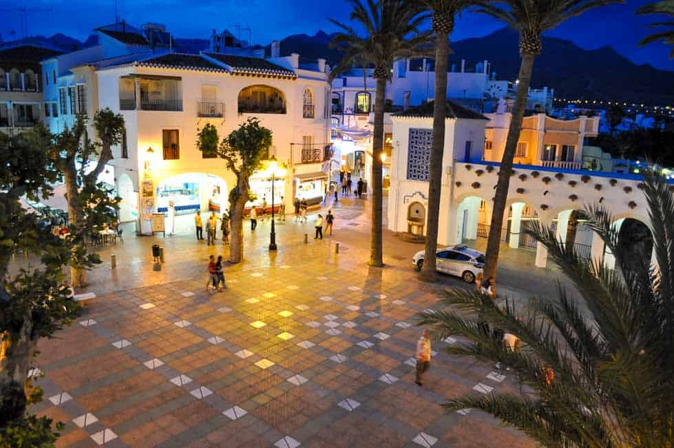 Main Square in Nerja, Spain on the Costa del Sol. How to host a Paella Party in your kitchen. Tips for making paella, a traditional Spanish rice and seafood dish. Step-by-step instructions for a successful paella party!