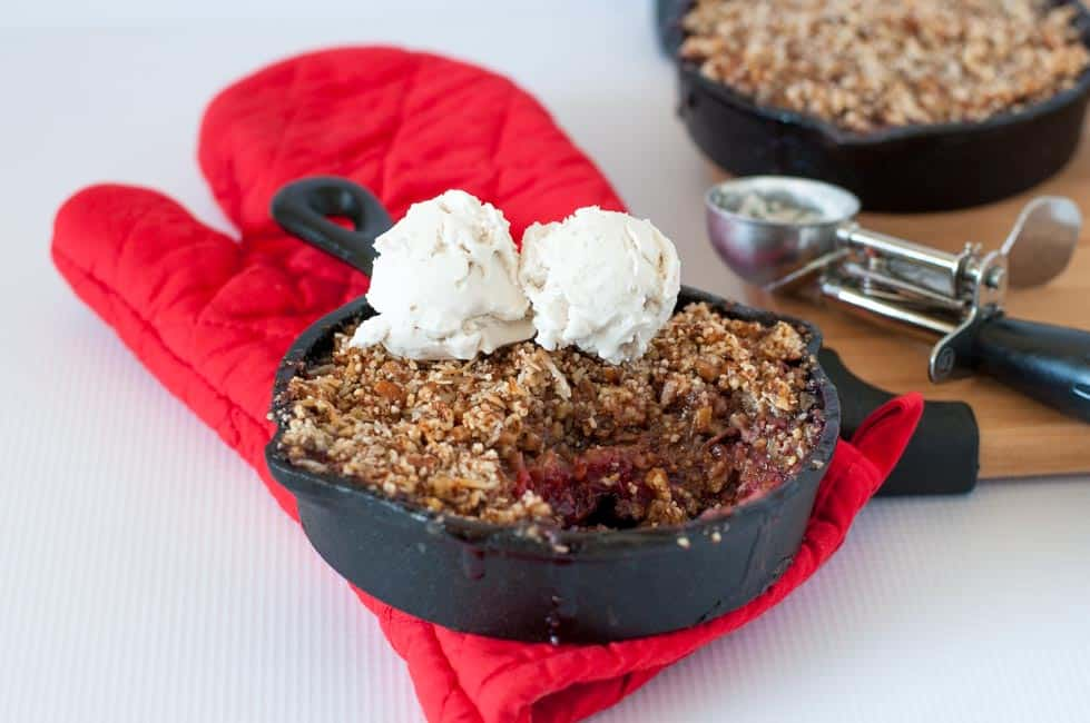 Rhubarb Raspberry Crisp with Crunchy Pecan Topping. Gluten-free and paleo! Sweet and tiny bit tart. Baked in a personal-sized skillet. Serve with dairy-free frozen ice cream.