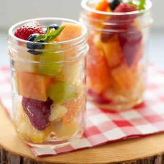 Mason Jar Boozy Tropical Fruit Salad in Mason Jars.