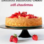 Gluten-Free Lemon Almond Cake with Strawberries on a black pedestal cake stand