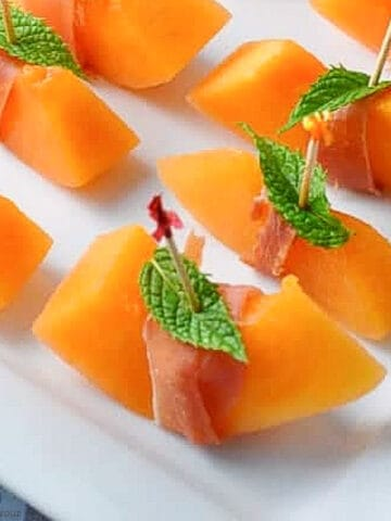 close up view of prosciutto wrapped melon