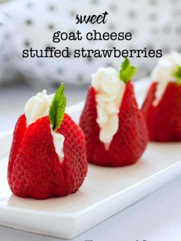 Sweet goat cheese stuffed strawberries with mint sprigs