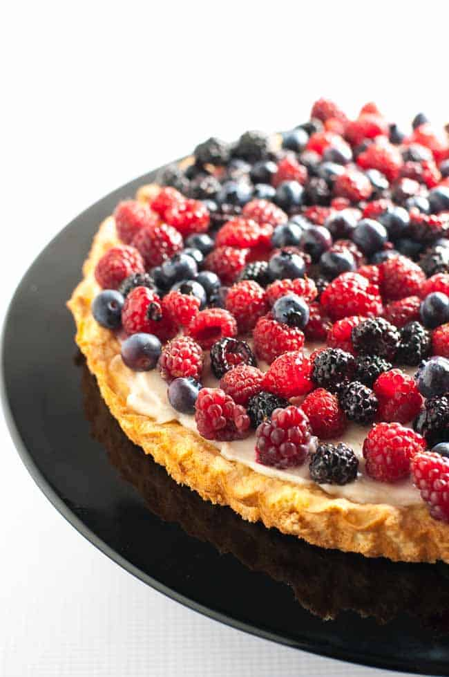 Gluten-Free Fruit Flan with Ricotta and Berries. Tender cake base topped with lightly sweetened ricotta cheese and honey-drizzled fresh berries. |www.flavourandsavour.com