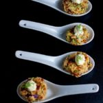 Crispy Smoked Salmon Zucchini Cakes on white porcelain spoons