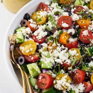 Mediterranean Quinoa Salad with a pitcher of Lemon Herb Dressing
