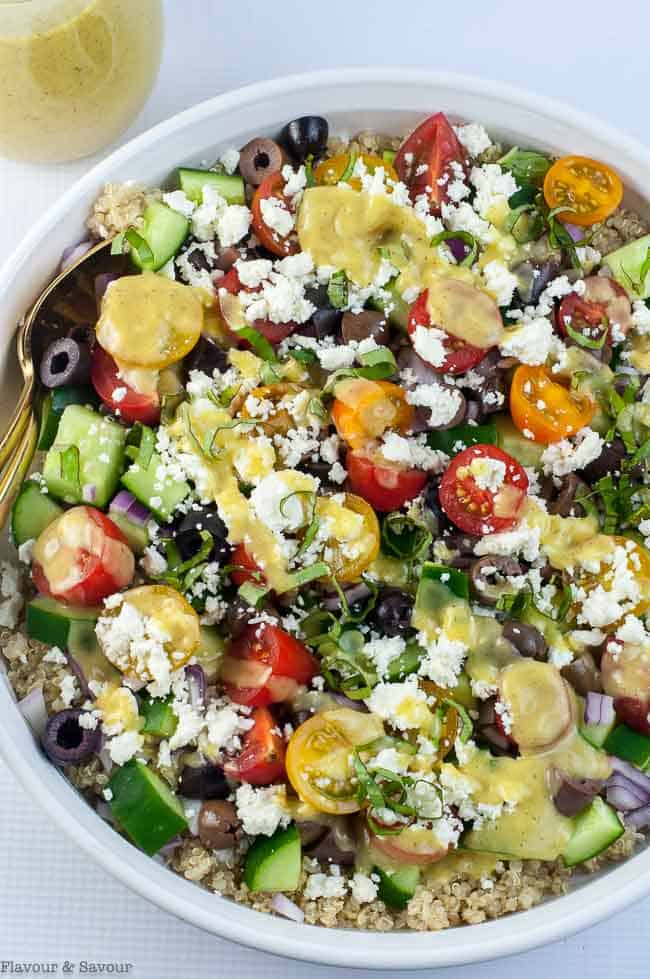 overhead view of Mediterranean Quinoa Salad with tomatoes, cucumbers, olives and feta