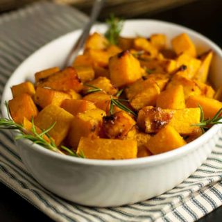 It's a little sweet, a little spicy and this crispy Maple Dijon Roasted Butternut Squash will be an ideal side dish for fall or winter dinner. | Vegan and Paleo. www.flavourandsavour.com