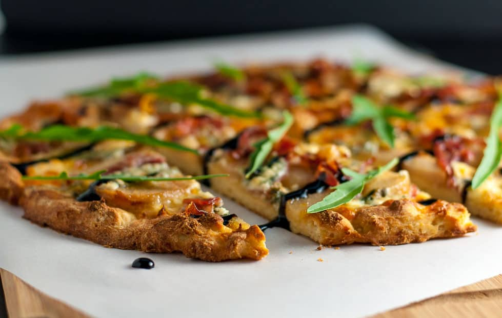 Caramelized Pear, Prosciutto and Blue Cheese Pizza. It's gluten-free! It has a unique combination of sweet pears, salty prosciutto, and sharp blue cheese that's all tied together with a drizzle of rich balsamic vinegar. |www.flavourandsavour.com