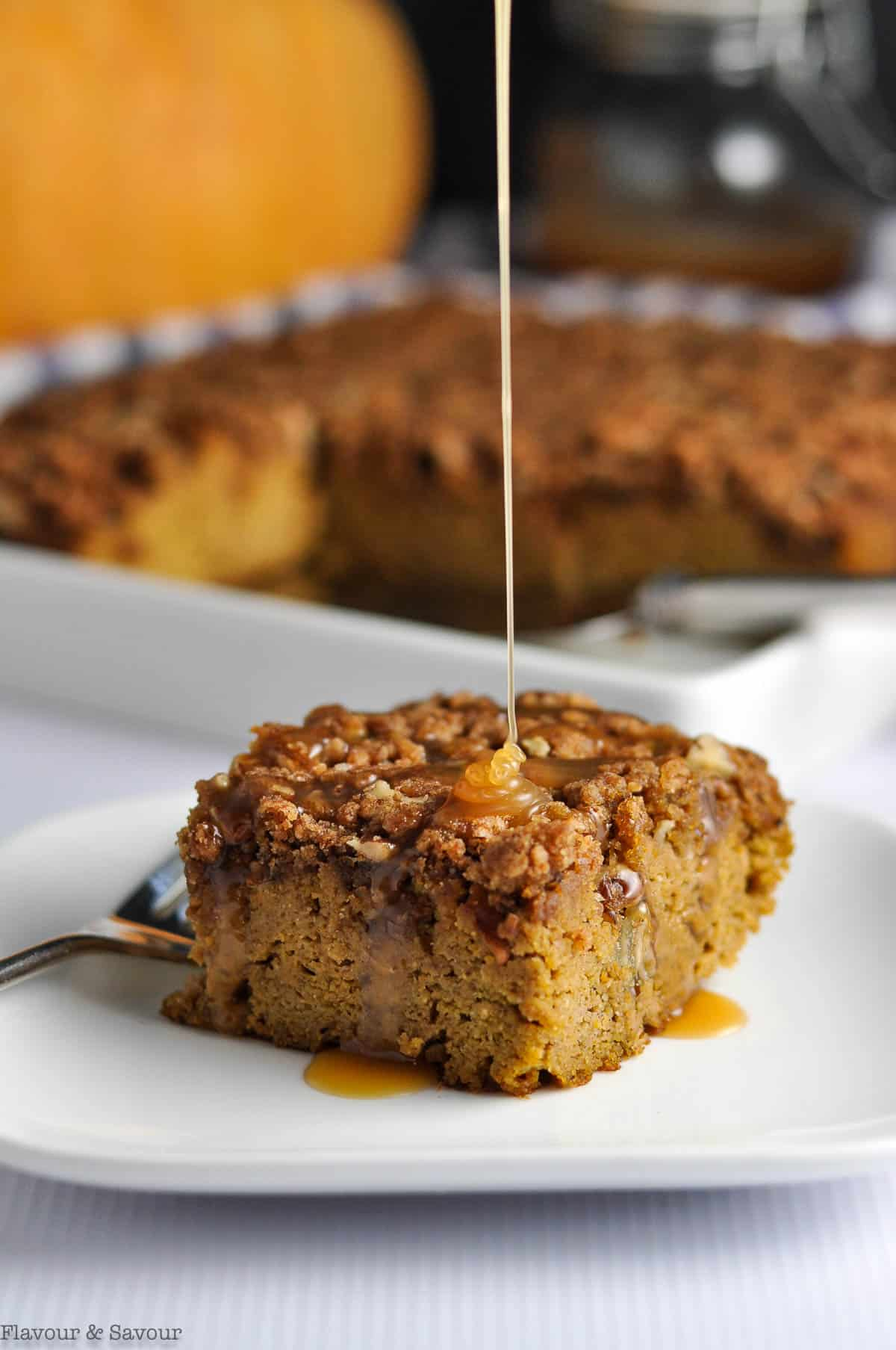Drizzling caramel sauce on Pumpkin Pecan Coffee Cake