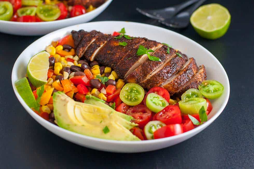 Southwestern Fiesta Baked Chicken Bowl. All your favourite Tex-Mex flavours in one meal-in-a-bowl with avocado, tomatoes, born and beans! |www.flavourandsavour.com