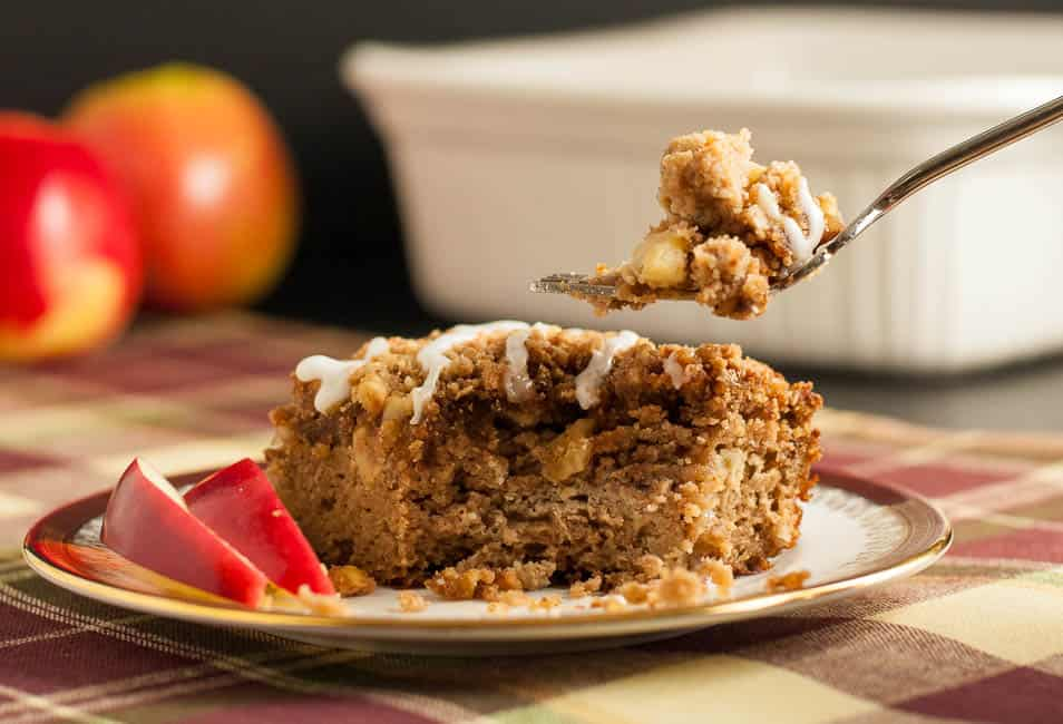 A slice of Gluten-Free Apple Cinnamon Coffee Cake with fresh apple slices