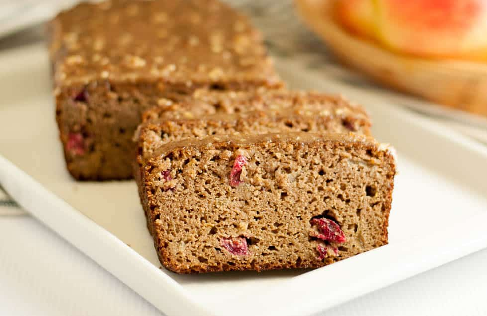 a loaf of Apple Cranberry Bread sliced