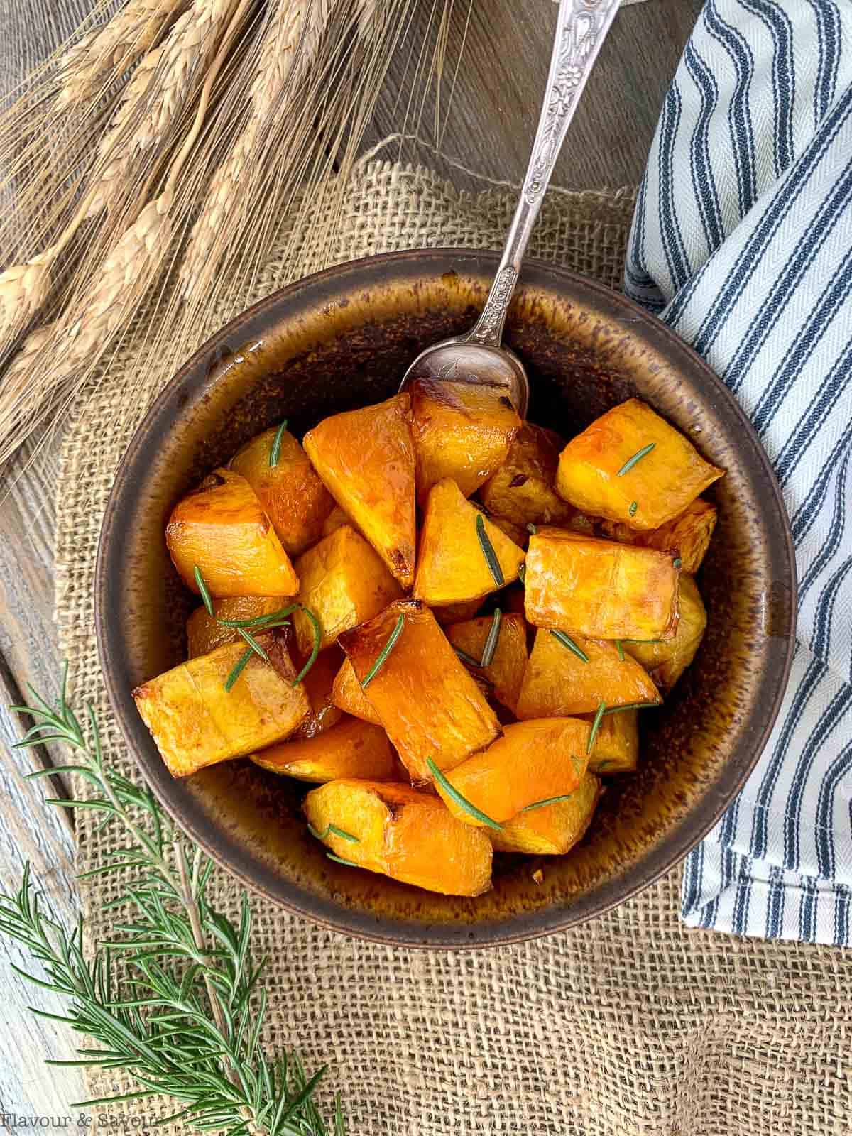 Overhead view of a bowl of Maple Dijon Roasted Butternut Squash with a spoon