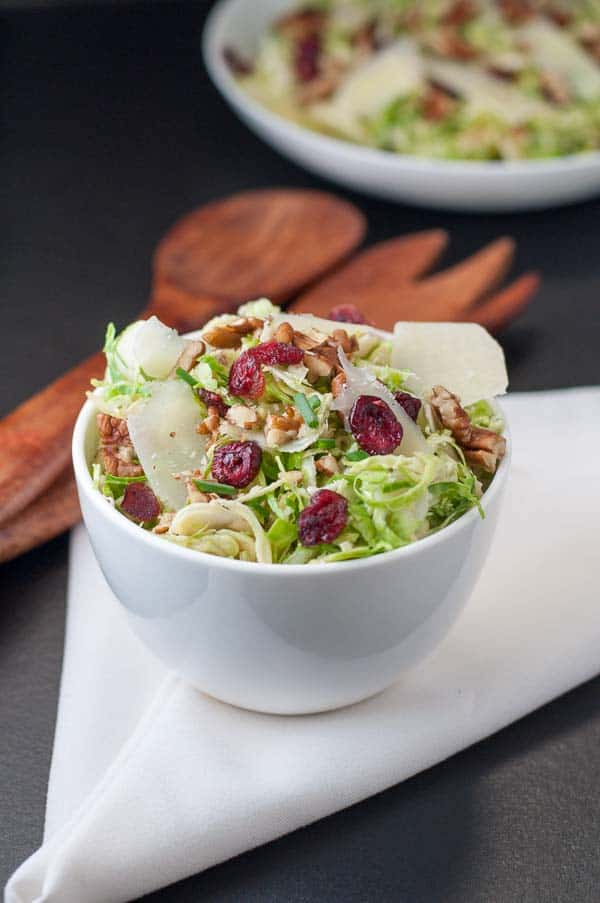 Shaved Brussels Sprout Salad with Cranberries. Here's a welcome alternative to cooked Brussels Sprouts. This salad is fresh and crunchy and makes an easy side dish to make ahead of time. Just one of Flavour and Savour's collection of gluten free holiday side dishes.|www.flavourandsavour.com