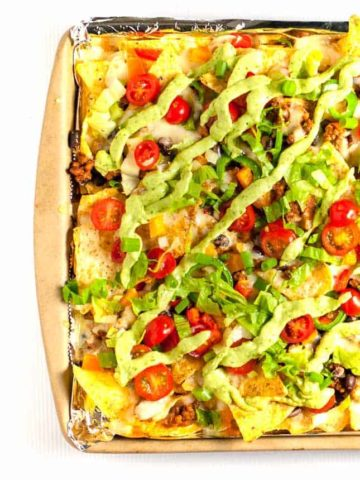 Loaded Chicken Veggie Sheet Pan Nachos with Black Beans and Avocado Cream |www.flavourandsavour.com