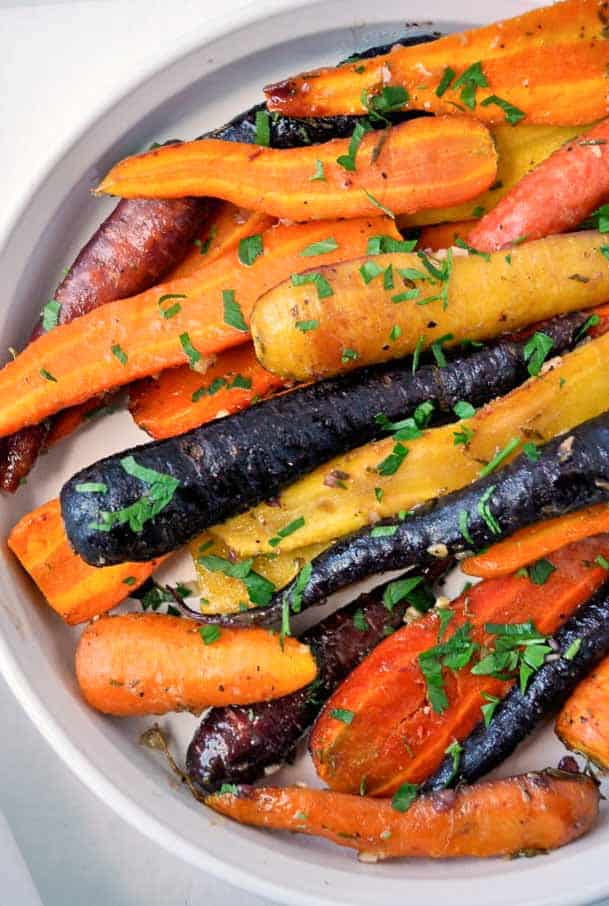 These Roasted Carrots with Honey-Mustard glaze are a popular side dish for holiday meals. Just one of Flavour and Savour's collection of gluten free holiday side dishes.. |www.flavourandsavour.com