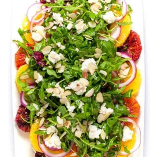 Citrus Salad with Arugula and Goat Cheese. Fresh sweet oranges, fresh mint and spicy arugula topped with tangy cheese and flaked almonds make a beautiful winter salad. |www.flavourandsavour.com