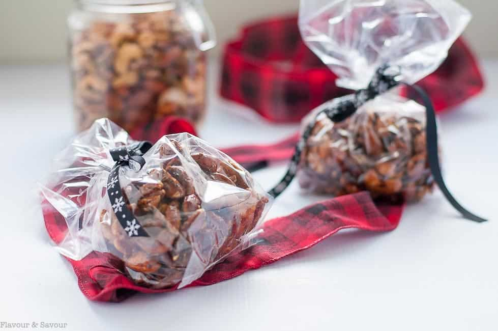 Espresso Glazed Holiday Nut Mix packaged in cellophane bags with ribbon for gifts |www.flavourandsavour.com