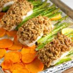Maple Dijon Walnut Crusted Sheet Pan Halibut with crispy sweet potato chips and asparagus. A one-pan paleo meal that cooks in only 10 minutes. |www.flavourandsavour.com