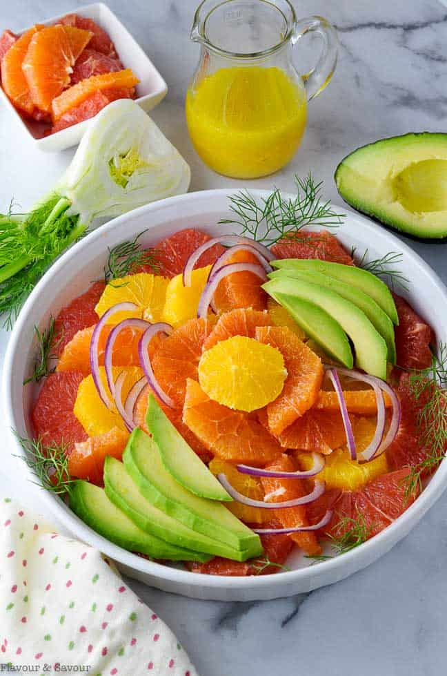 Citrus Salad with Avocado arranged concentriically in a round shallow dish