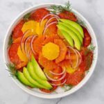 Overhead View of Grapefruit-Orange Avocado Salad with Ginger-Orange Dressing