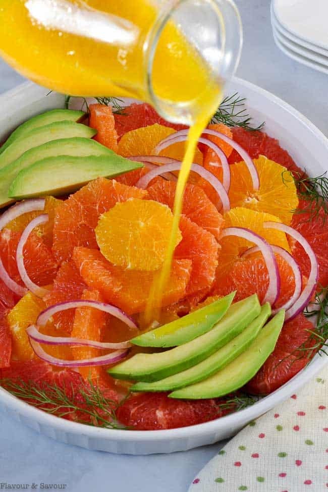 Pouring dressing on Winter Citrus Salad
