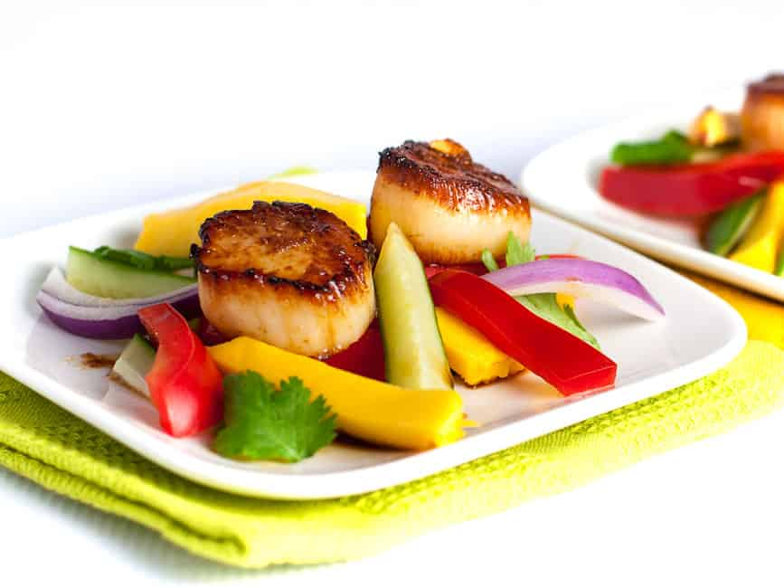 Seared Scallops with Mango Salad.Discover three simple steps to create perfectly seared scallops, and serve them on a colourful salad made with thinly sliced mango, red pepper, cucumber and red onion.